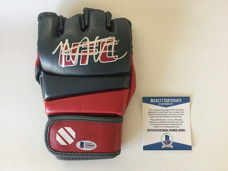 Khabib Nurmagomedov The EAGLE Signed Autographed UFC Glove Beckett BAS COA ee - Beckett Authentication