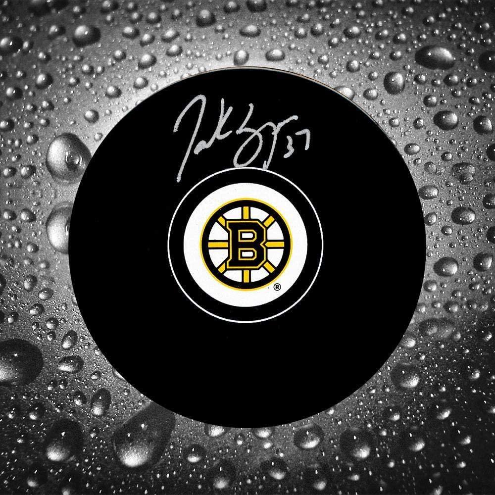 Patrice Bergeron Autographed Hockey Puck - Autographed NHL Pucks