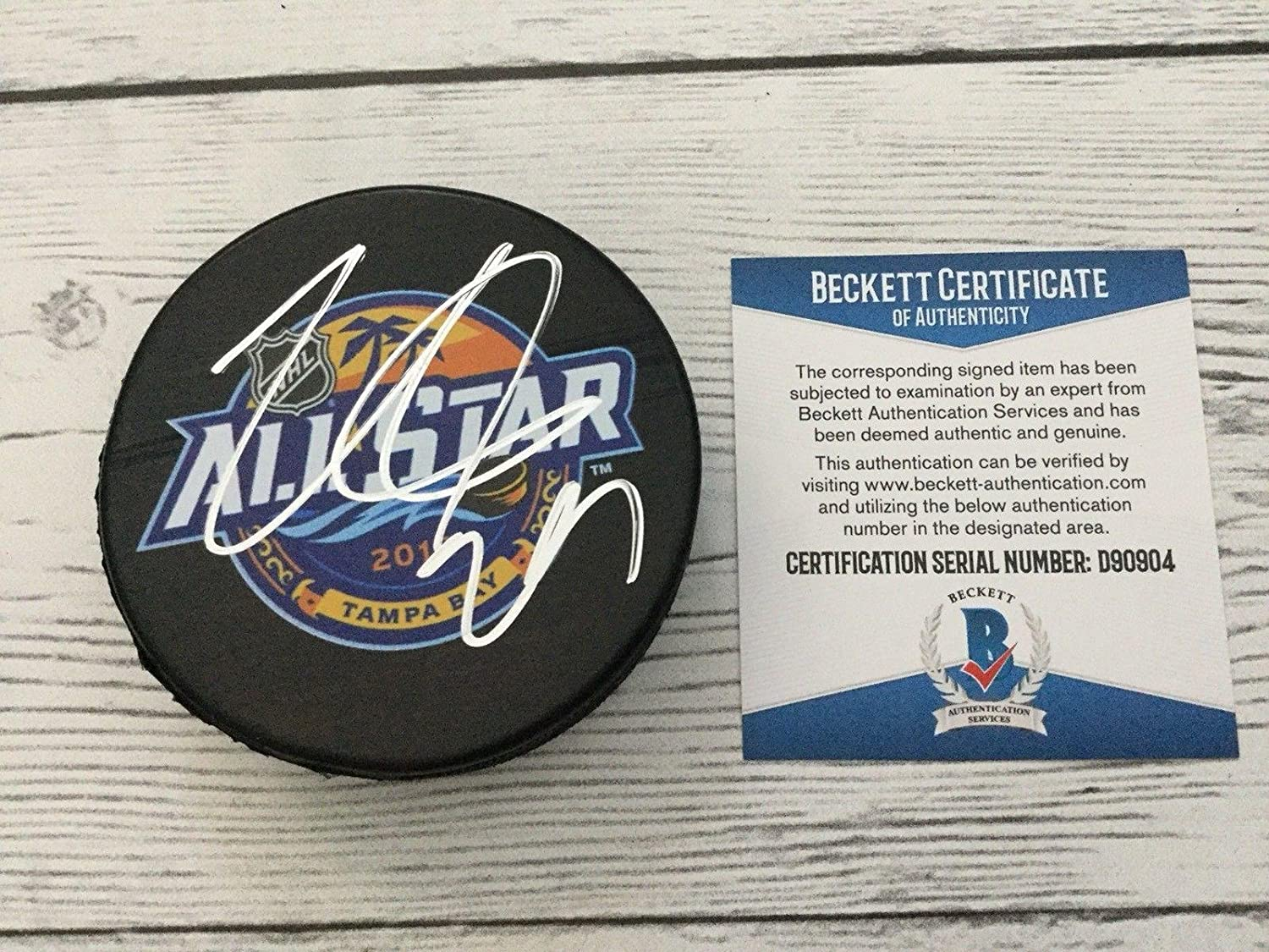 Autographed Nathan MacKinnon Hockey Puck - 2018 NHL All Star Beckett BAS a - Beckett Authentication - Autographed NHL Pucks