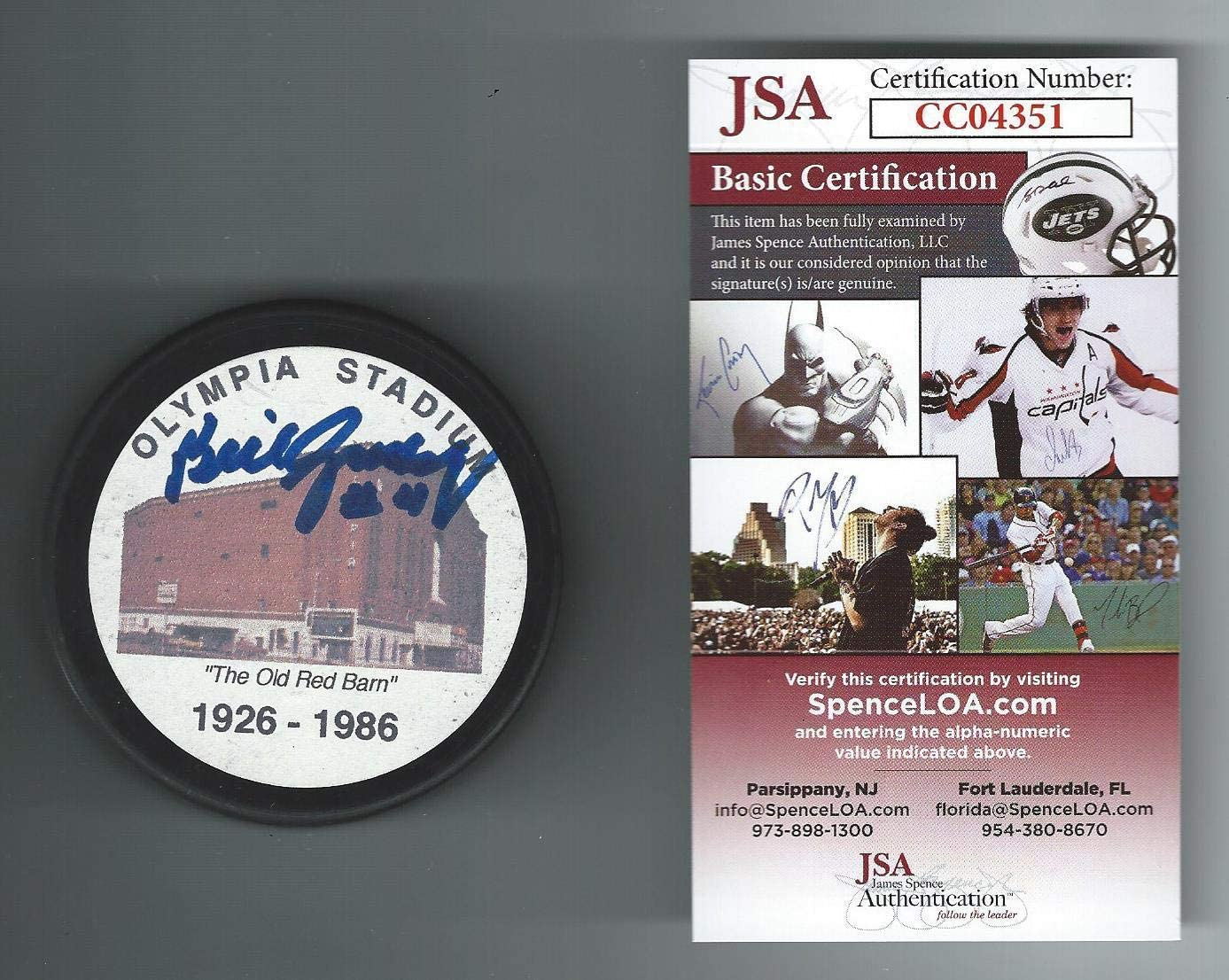 Bill Gadsby Autographed Hockey Puck - Olympia Stadium Authenticated - JSA Certified - Autographed NHL Pucks