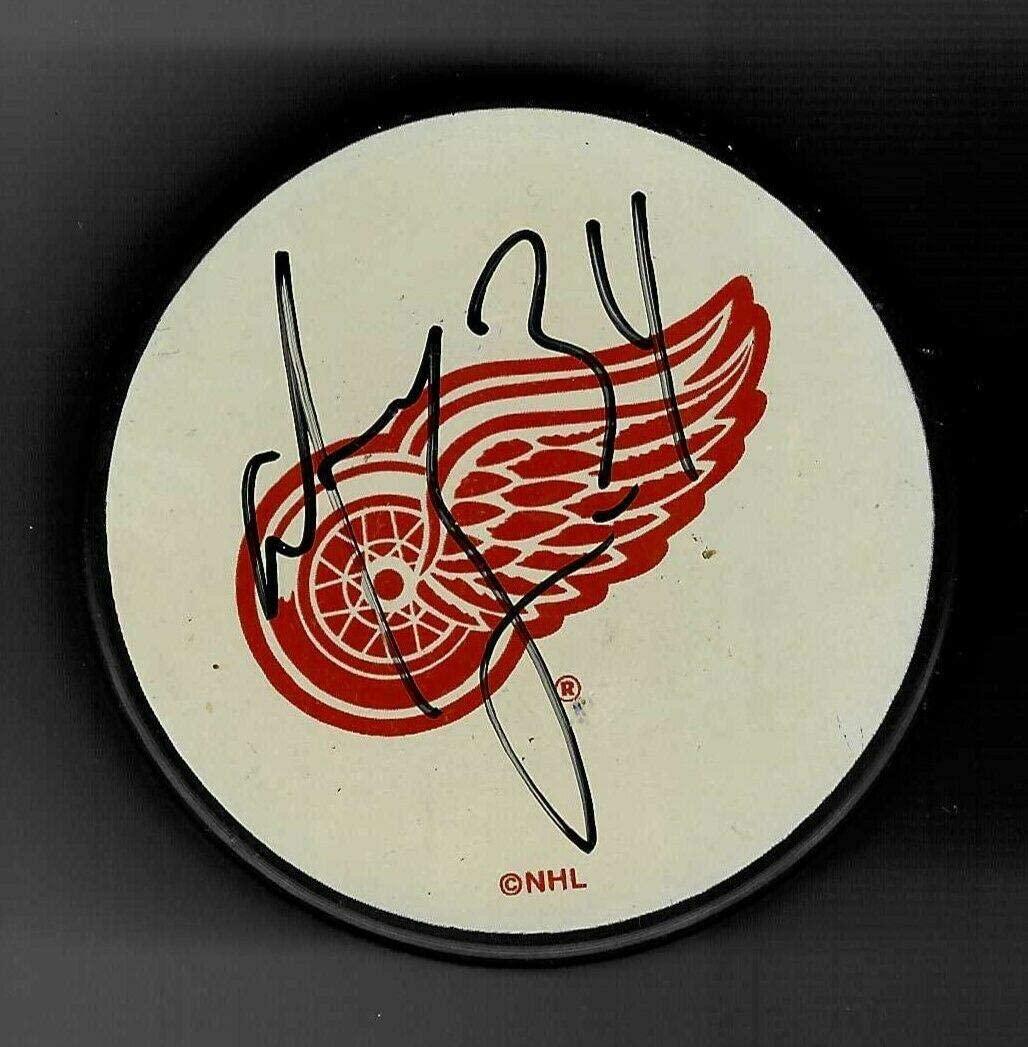 Manny Legace Autographed Puck - White Logo - Autographed NHL Pucks