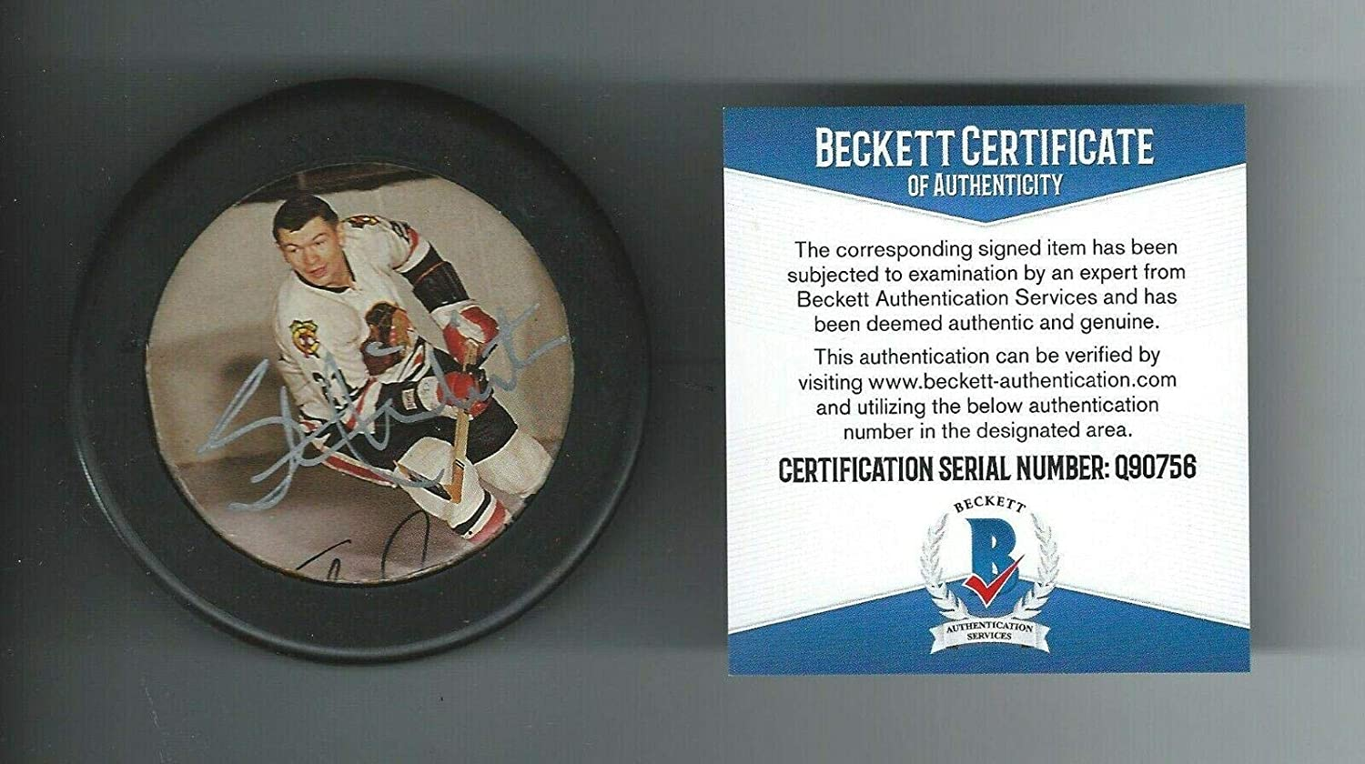 Stan Mikita Autographed Puck - Photo Beckett COA - Beckett Authentication - Autographed NHL Pucks