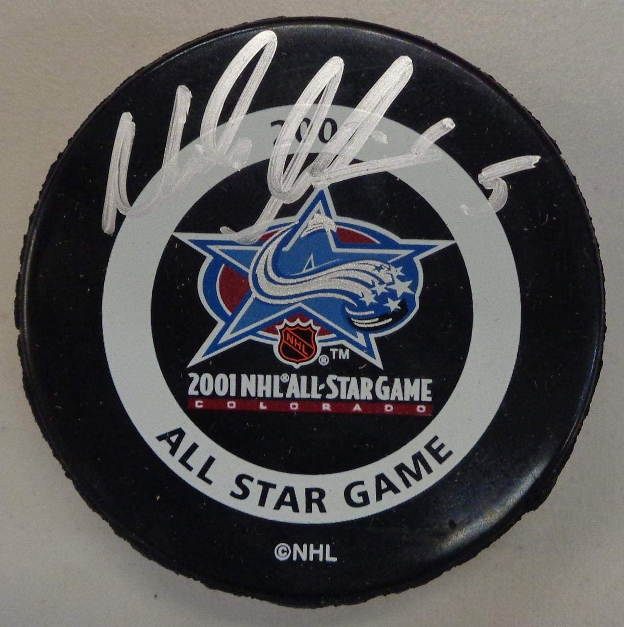Autographed Nicklas Lidstrom Puck - 2001 All Star - Autographed NHL Pucks