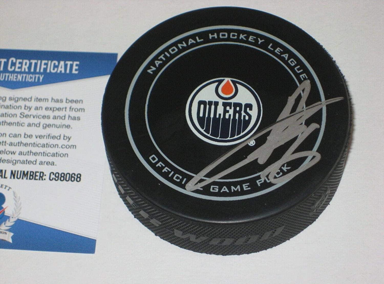 Adam Larsson Signed Hockey Puck - Official w Beckett COA - Beckett Authentication - Autographed NHL Pucks