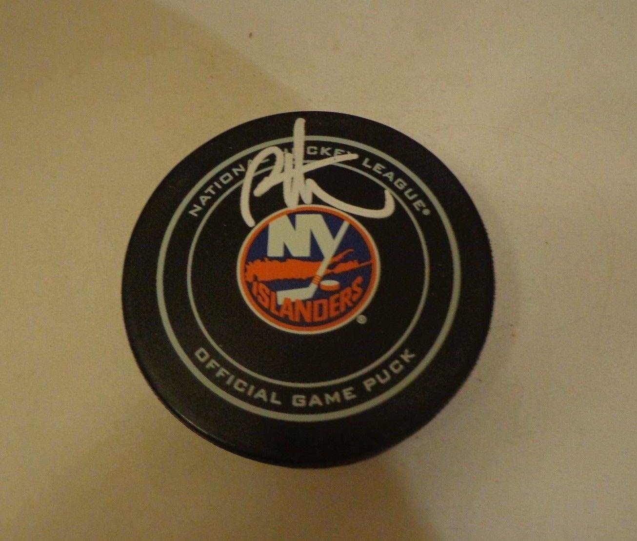 Bryan Trottier Signed Hockey Puck - Official HOF - Autographed NHL Pucks