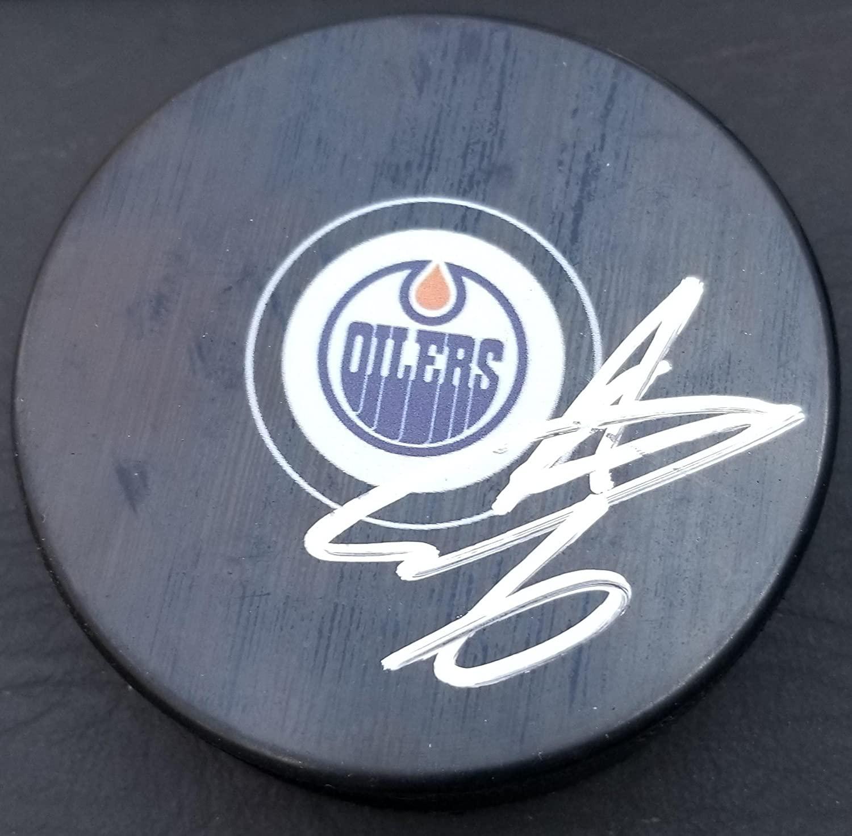 Signed Adam Larsson Hockey Puck - Autographed NHL Pucks