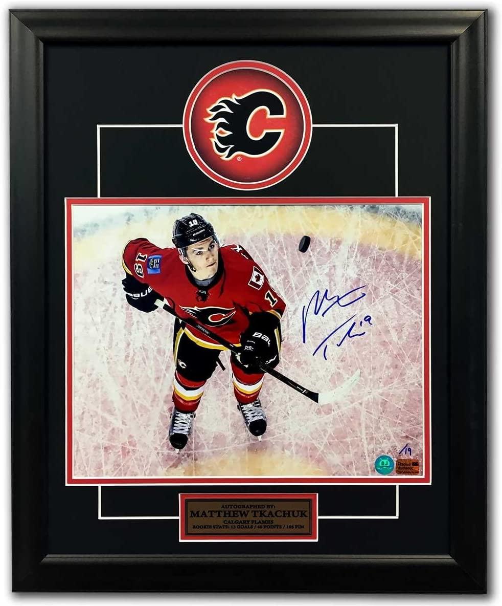 Autographed Matthew Tkachuk Hockey Puck - Overhead Wizard 19x23 Frame #/19 - Autographed NHL Pucks