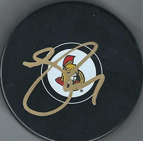 Johnny Oduya Autographed Hockey Puck - Autographed NHL Pucks