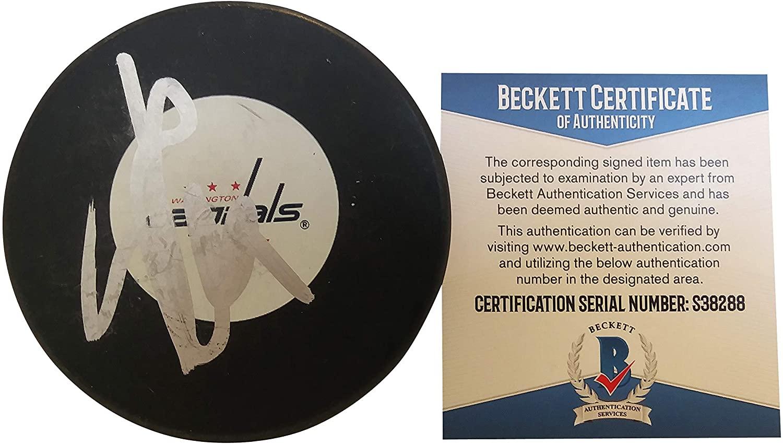 John Carlson Autographed Signed Washington Capitals Logo Ice Hockey Puck with Exact Proof Photo of Signing and Beckett Authentication BAS COA S38288