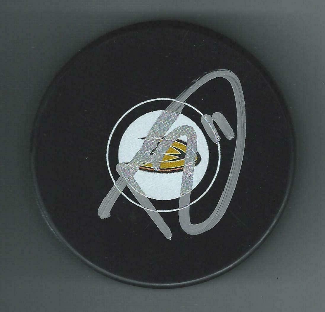 Trevor Zegras Autographed Hockey Puck - Autographed NHL Pucks