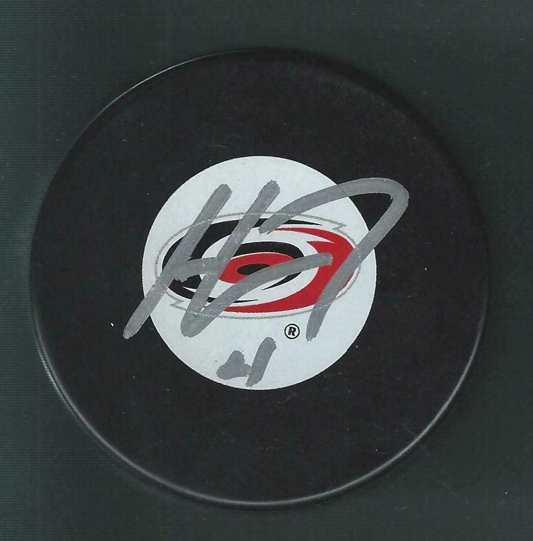 Autographed Haydn Fleury Hockey Puck - Large Logo - Autographed NHL Pucks