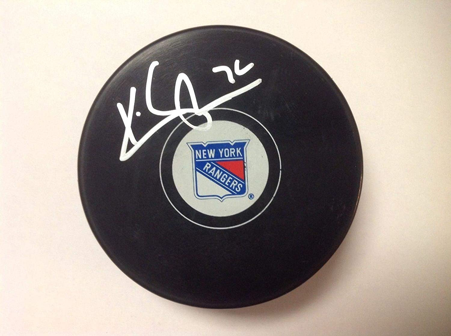 Autographed Kevin Shattenkirk Puck - NY c - Autographed NHL Pucks