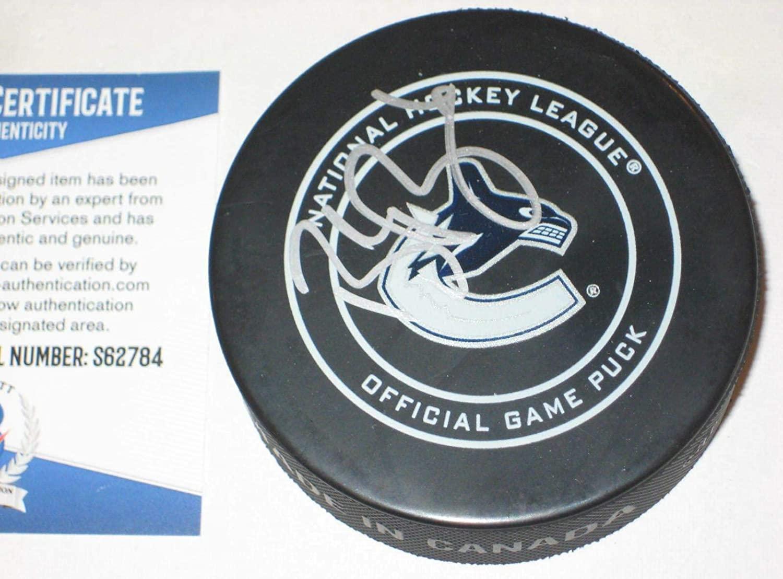 Autographed Brock Boeser Puck - Official w Beckett COA - Beckett Authentication - Autographed NHL Pucks