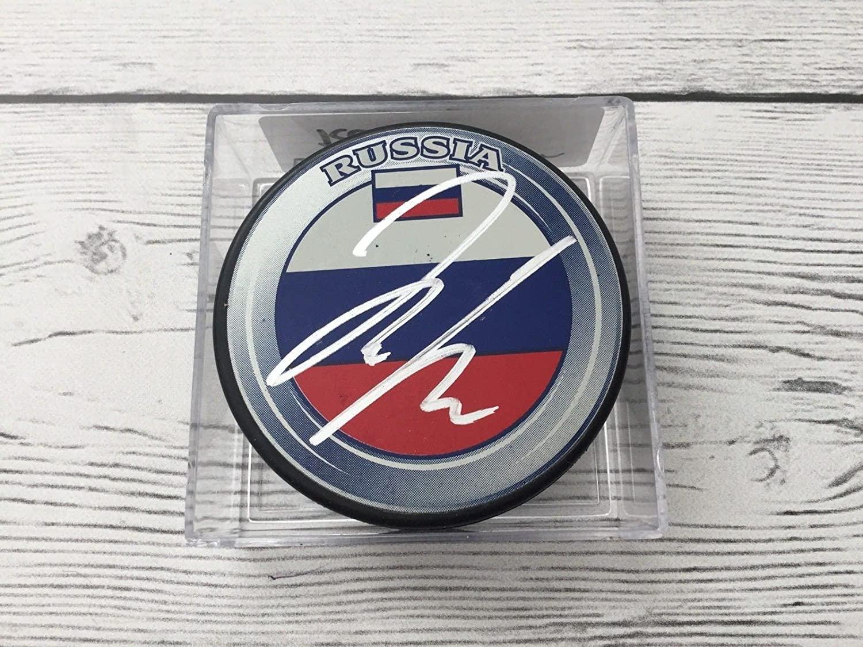 Dmitrij Jaskin Autographed Hockey Puck - Team Russia a - Autographed NHL Pucks