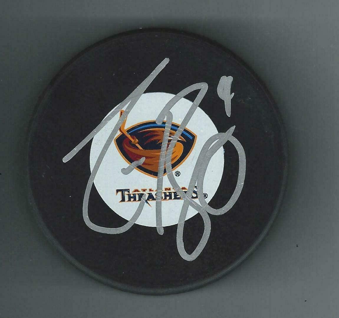 Autographed Zach Bogosian Puck - Autographed NHL Pucks