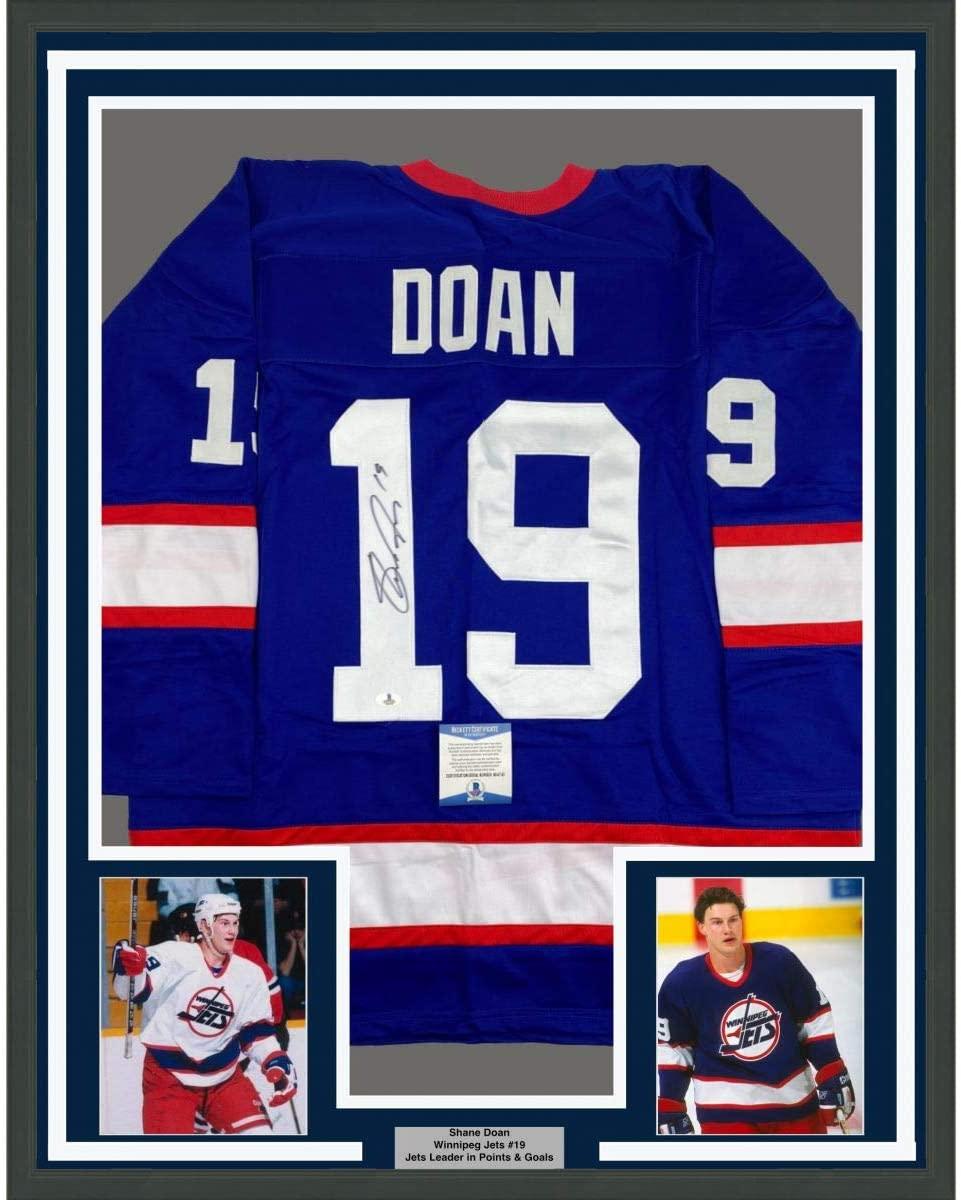 Framed Autographed/Signed Shane Doan 33x42 Winnipeg Blue Hockey Jersey Beckett BAS COA