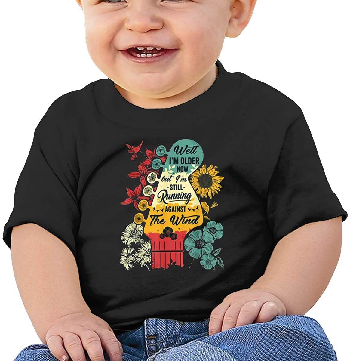 Funny Well I'm Older Now But I'm Still Running Against The Wind Bob Seger Comfortable Baby T-Shirt