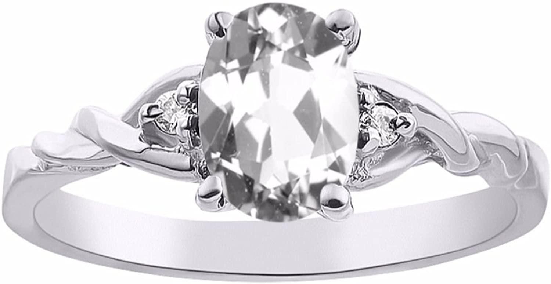Diamond & White Topaz Ring Set In 14K White Gold Solitaire