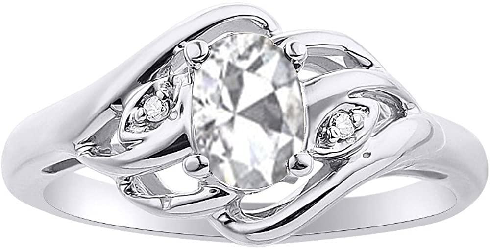 Diamond & White Topaz Ring Set In 14K White Gold Birthstone