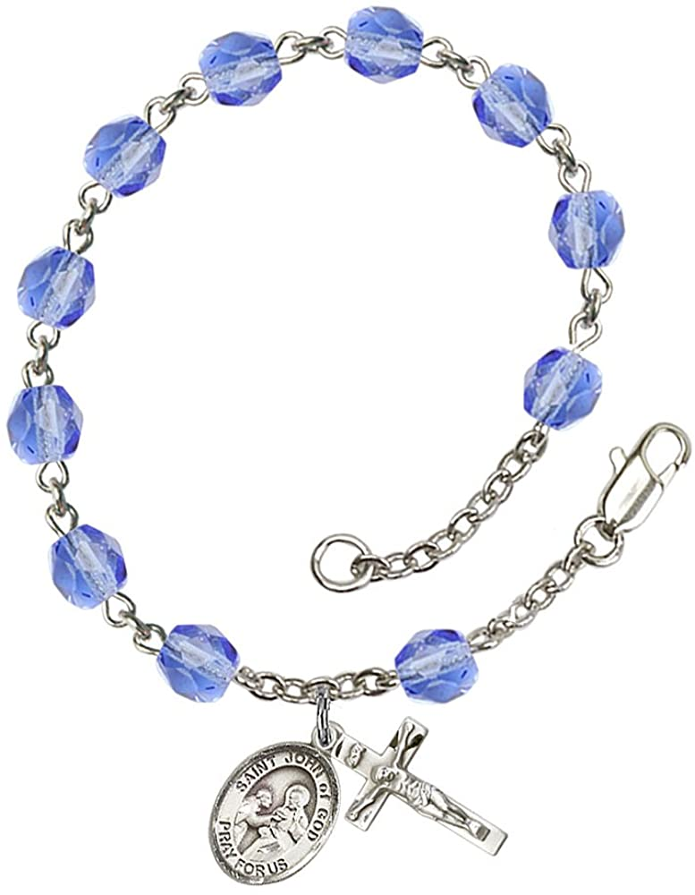 Silver Plate Rosary Bracelet features 6mm Sapphire Fire Polished beads. The Crucifix measures 5/8 x 1/4. The charm features a St. John of God medal. Patron Saint Alcoholics/The Sick