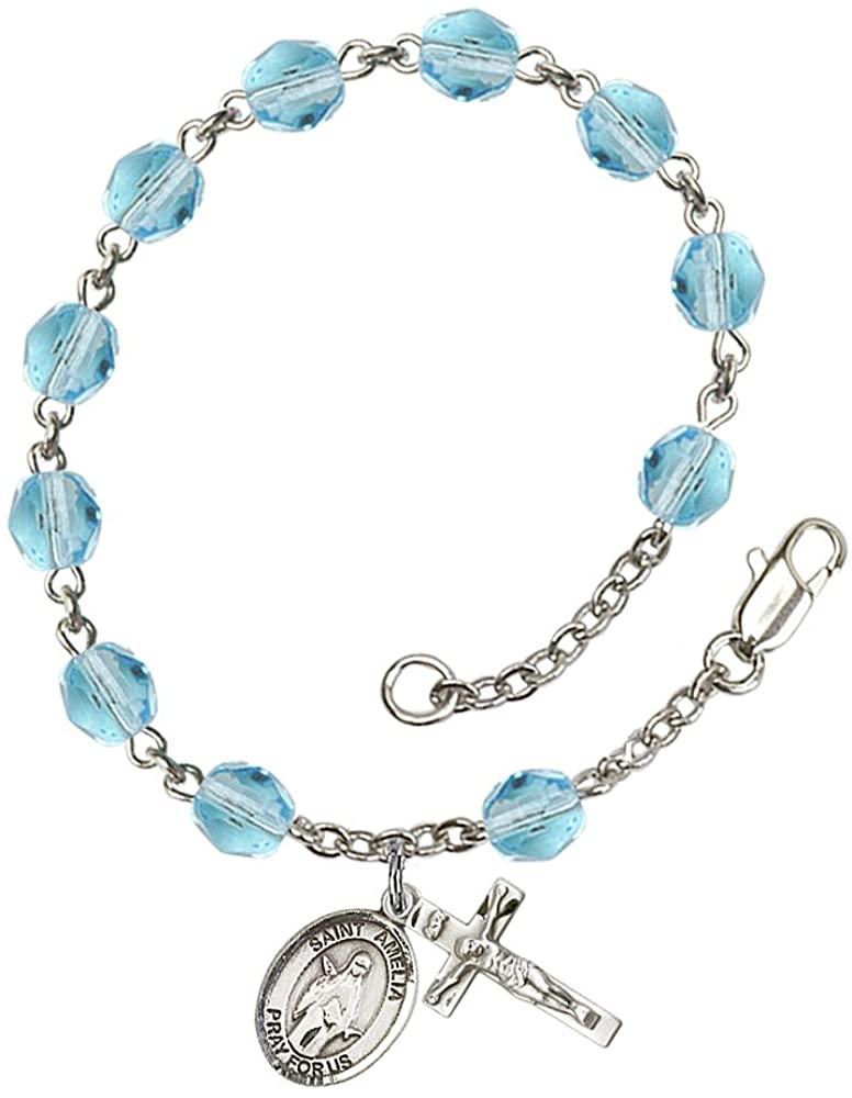 Silver Plate Rosary Bracelet features 6mm Aqua Fire Polished beads. The Crucifix measures 5/8 x 1/4. The charm features a St. Amelia medal. Patron Saint Arm Pain/Bruises
