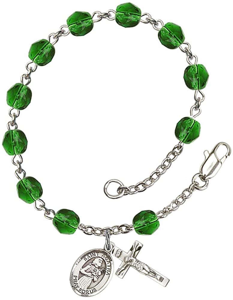 Silver Plate Rosary Bracelet features 6mm Emerald Fire Polished beads. The Crucifix measures 5/8 x 1/4. The charm features a St. Agatha medal. Patron Saint Nurses/Breast Cancer