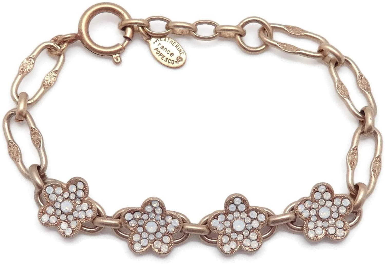 Catherine Popesco White Opalescent Swarovski Crystal Four Flower Link Goldtone Bracelet