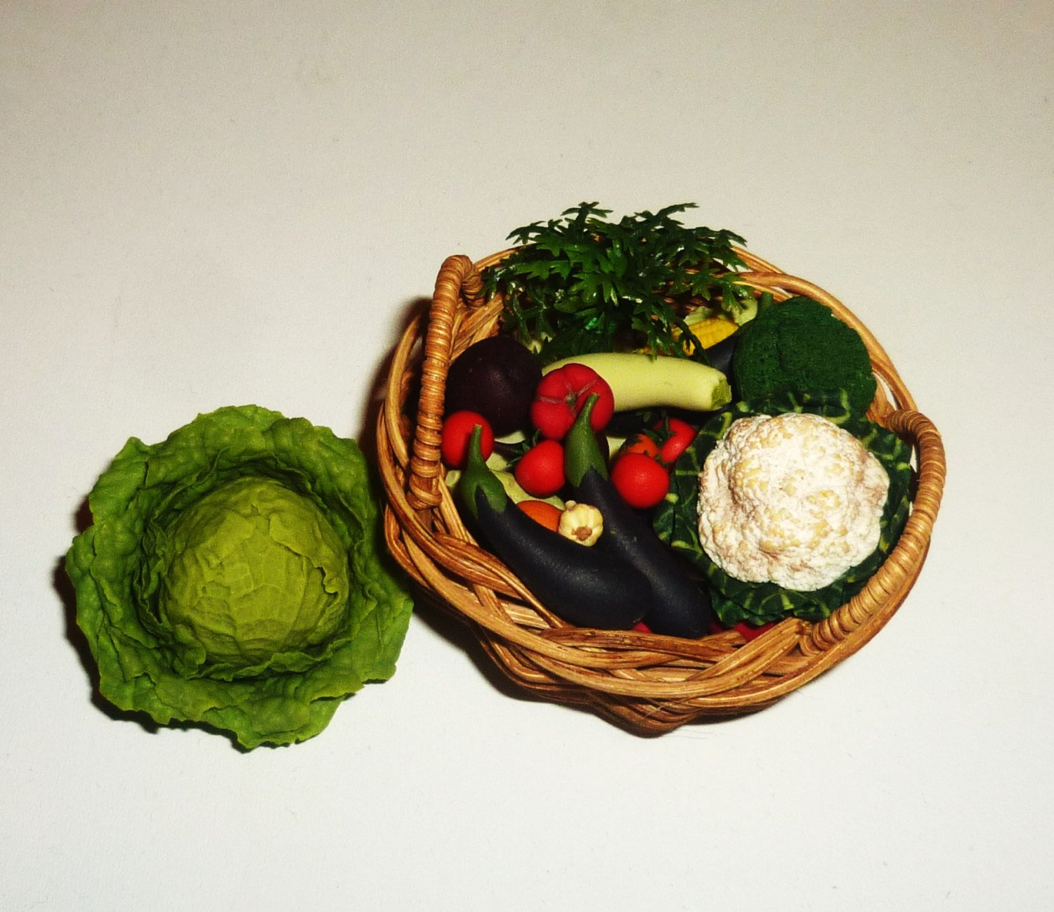 Wicker basket with vegetables. Dollhouse miniature 1:12