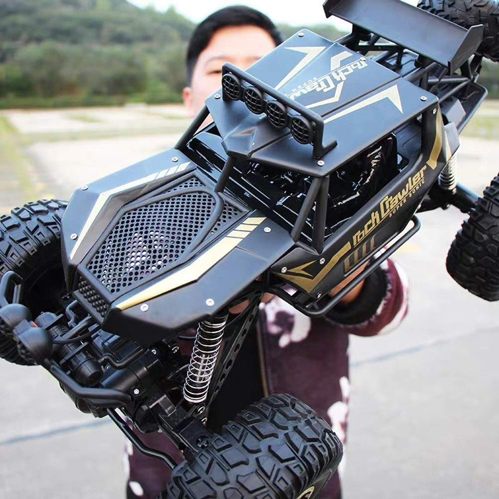 Kikioo 1/10 Scale Wireless Rechargeable Large RC Climbing Car Monster Truck High Speed Remote Control Car Boys Toys 2.4G Radio Controlled Vehicle 4WD Alloy RC Off Road Buggy for Snow Gravel Grassland