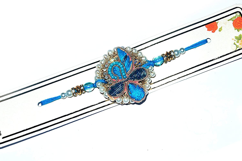 Rakhi in Bright Blue Color with jardoshi Pattern.