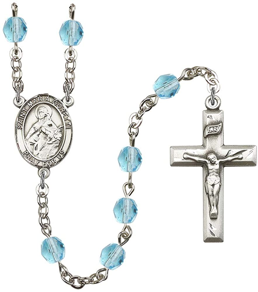 Silver Plate Rosary features 6mm Aqua Fire Polished beads. The Crucifix measures 1 3/8 x 3/4. The centerpiece features a St. Maria Goretti medal. Patron Saint Teenage Girls