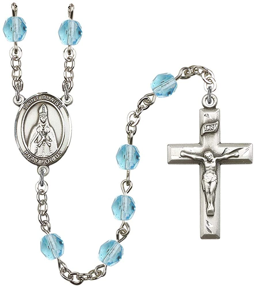 Silver Plate Rosary features 6mm Aqua Fire Polished beads. The Crucifix measures 1 3/8 x 3/4. The centerpiece features a St. Blaise medal. Patron Saint Throat Ailments