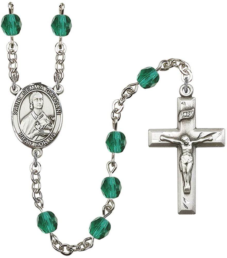 Silver Plate Rosary features 6mm Zircon Fire Polished beads. The Crucifix measures 1 3/8 x 3/4. The centerpiece features a St. Gemma Galgani medal. Patron Saint Pharmacists