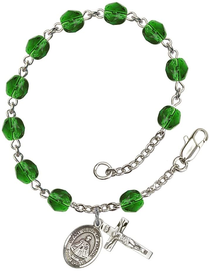 Silver Plate Rosary Bracelet Features 6mm Emerald Fire Polished Beads. The Crucifix Measures 5/8 x 1/4. The Charm Features a Infant of Prague Medal.