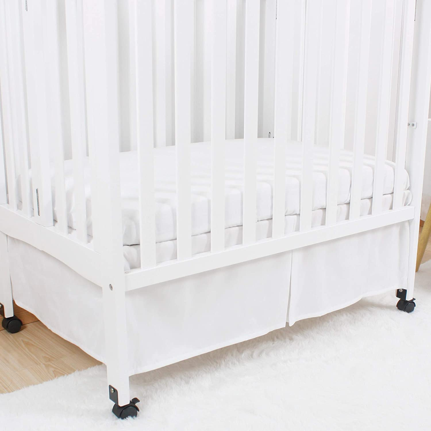 CaSaJa Mini Crib Skirt Pleated, Silk-Looking Soft Microfiber Baby Bed Skirt with Durable Platform for Mini and Portable Cribs 24