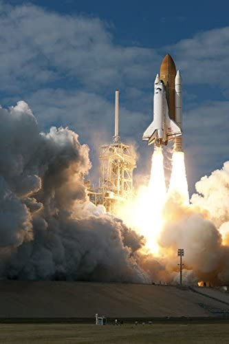 Space Shuttle Atlantis lifts off from its launch pad at Kennedy Space Center Florida Poster Print by Stocktrek Images (22 x 34)