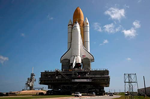 Space Shuttle Discovery makes its way to the launch pad at Kennedy Space Center Poster Print by Stocktrek Images (34 x 22)