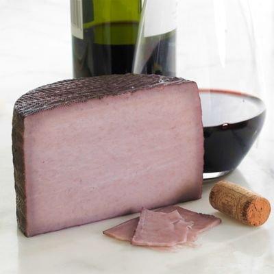 Artequeso Red Wine Infused Goat's Milk Cheese from La Mancha (1.1 lb/ 17.6 oz - half wheel)
