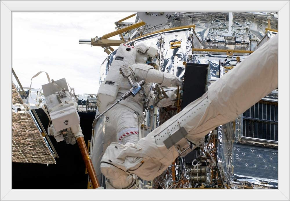Astronauts Working on The Hubble Space Telescope During a Spacewalk White Framed Art Print, 39.